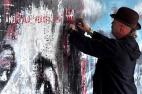 Spraying up a storm at Bristol's UPFEST urban art festival.