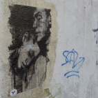 """""""Ordinary Lives"""", conte and pastel on newspaper and on a wall. Free public art."""
